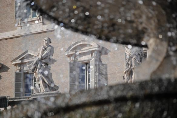 Another view of a statue through a fountain at St Peters Basillica, this time with a blurred foreground