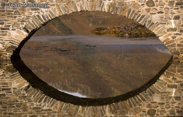 Reflection of Eilean Donan footbridge